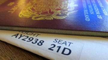 Picture of passport and boarding pass.