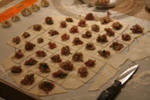 Picture of the making of mantı, also called Turkish ravioli.